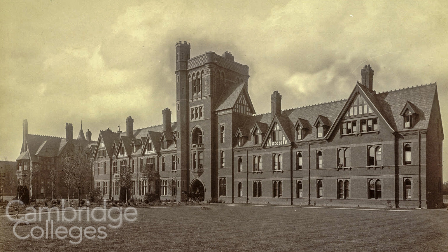 The main entrance to Girton College, with it's parapetted tower, monochrome